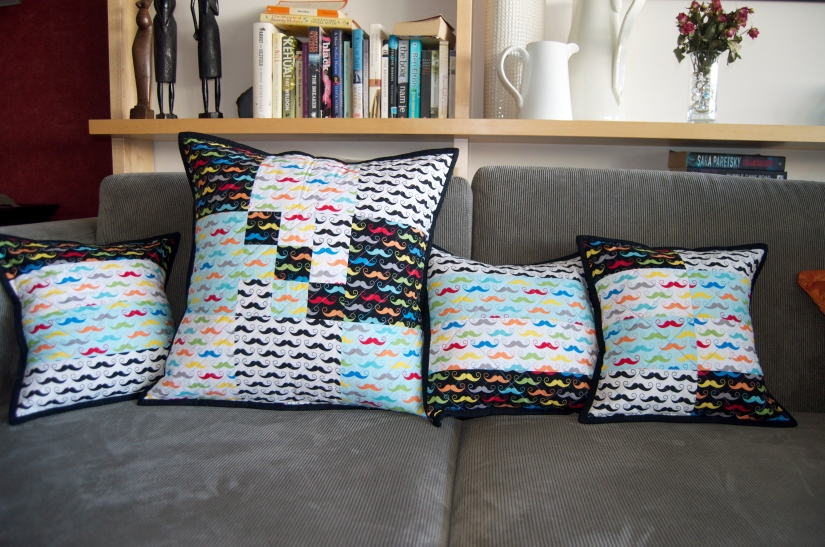 Mustachioed – Riley Blake's Geekly Chic Moustache Cushions.